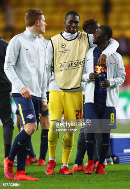 Yvon Mvogo and Naby Keita of RB Leipzig celebrate after the UEFA Champions League group G match between AS Monaco and RB Leipzig at Stade Louis II on...