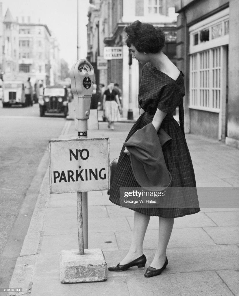 Yvonne Brecher examining a newlyinstalled parking meter fitted with an aparently incongruous 'No Parking' sign in Upper Brook Street London 10th July...