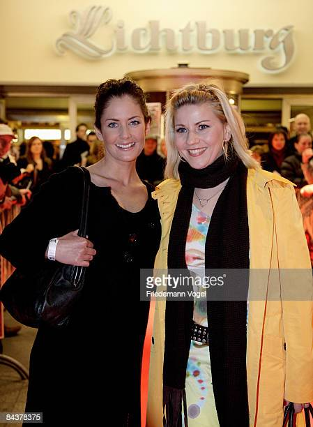 Yvonne Burbach and Alexandra Bechtel pose on the red carpet after arriving for the premiere of the film 'Lulu and Jimi' by director Oscar Roehler at...