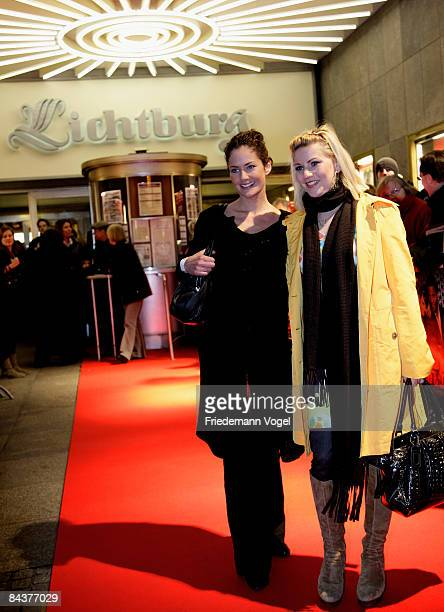Yvonne Burbach and Alexandra Bechtel pose on the red carpet as they arrive for the premiere of the film 'Lulu and Jimi' by director Oscar Roehler at...