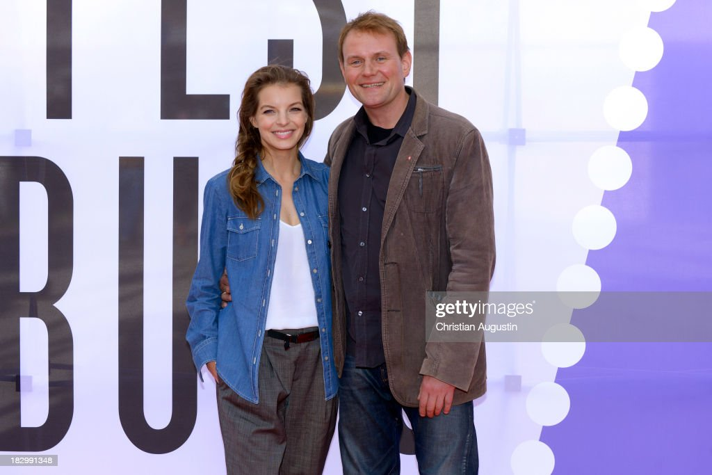 Yvonne Catterfeld and Devid Striesow attend the German premiere of the film 'Sputnik' at Cinemaxx on October 3 2013 in Hamburg Germany