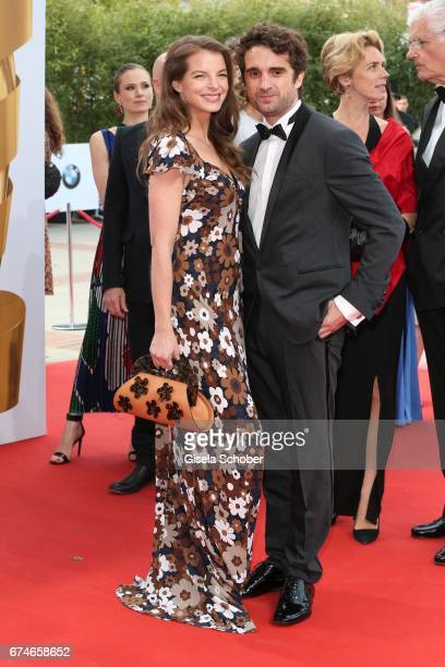 Yvonne Catterfeld and her partner Oliver Wnuk during the Lola German Film Award red carpet arrivals at Messe Berlin on April 28 2017 in Berlin Germany