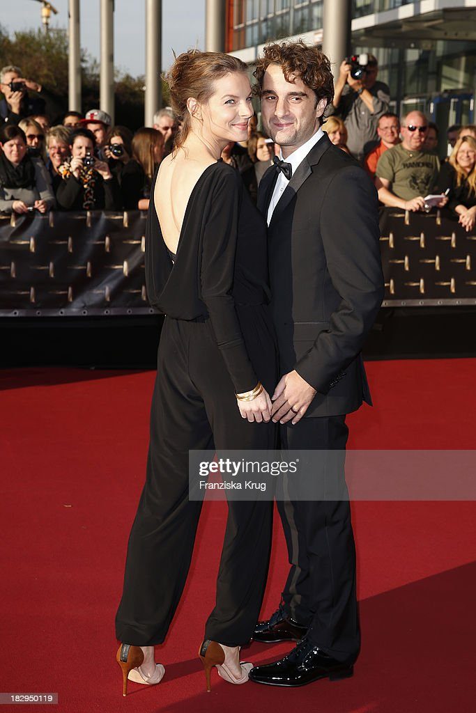 Yvonne Catterfeld and Oliver Wnuk attend the Deutscher Fernsehpreis 2013 Red Carpet Arrivals at Coloneum on October 02 2013 in Cologne Germany