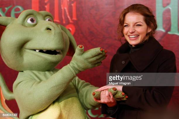Yvonne Catterfeld poses for the media with Hector the dragon during the premiere of the movie 'Lilli The Witch The Dragon And The Magical Book' on...