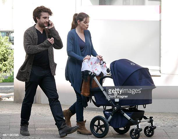 Yvonne Catterfeld sighted with her baby son Charlie and partner Oliver Wnuk in the Prenzlauer Berg neighborhood on April 28 2014 in Berlin Germany