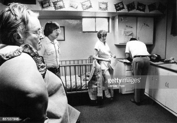 Yvonne Cavanaugh Left Watches As Officials Raid Her Tot College To her left are Lakewood police agent Al Walls Elizabethe Kestef Licensing...