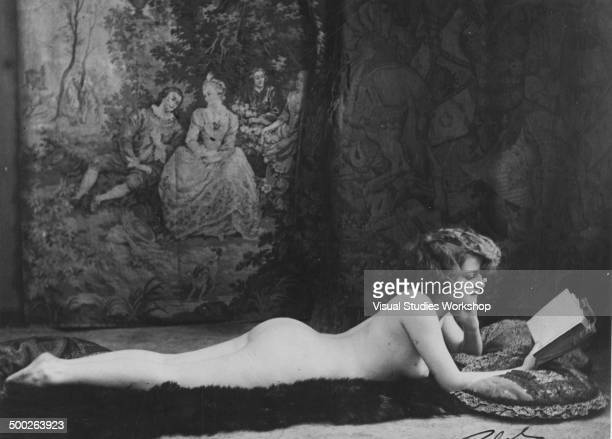 Yvonne Clarin awarded second prize in the Most Beautiful Figured Girl contest poses on a fur rug Paris France early to mid 20th century The contest...