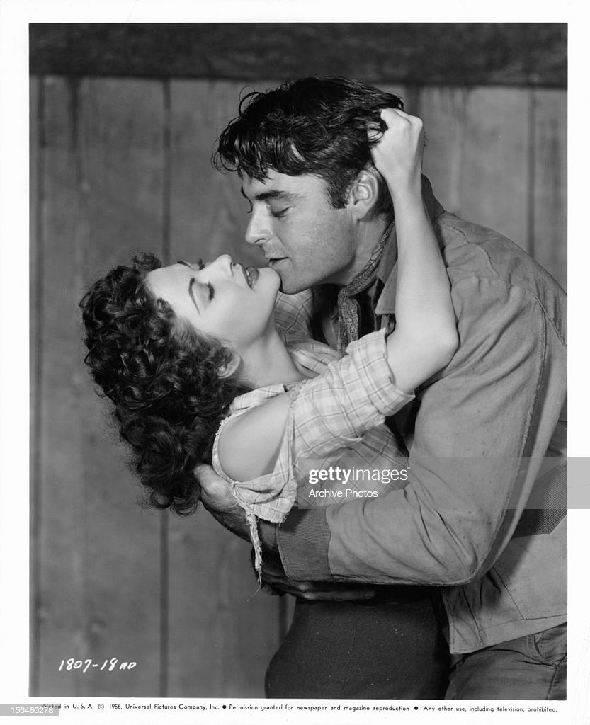 Yvonne De Carlo and Rory Calhoun embracing in publicity portrait for the film 'Raw Edge' 1956