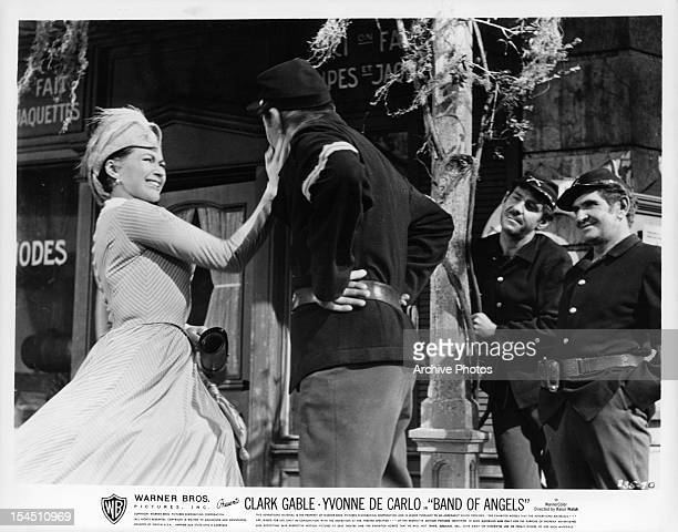 Yvonne De Carlo slapping the face of soldier in a scene from the film 'Band Of Angels' 1957