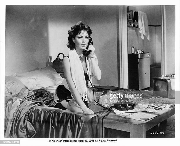 Yvonne Furneaux having phone conversation while sitting on the bed in a scene from the film 'La Dolce Vita' 1960