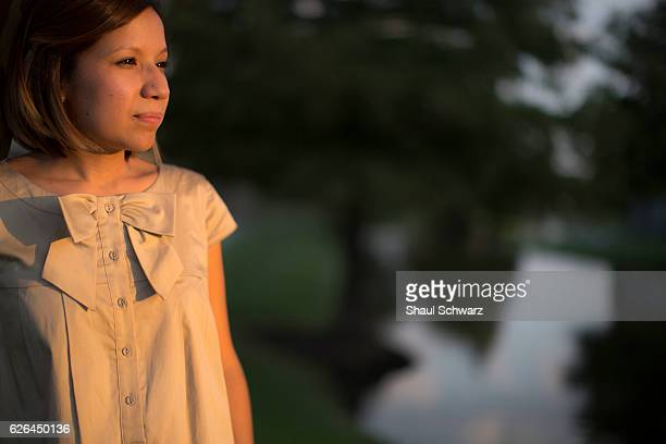 Yvonne Mendoza stands outside her house at sunset Yvonne is a first generation MexicanAmerican whose personal experiences with depression provide...