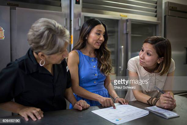 Yvonne Mendoza talks with her mom and sister at the family bakery Yvonne is a first generation MexicanAmerican whose personal experiences with...