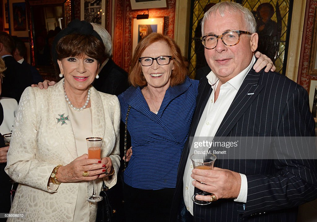 Yvonne Romain, guest and Christopher Biggins attend the launch of Dame Joan Collins' new book 'The St. Tropez Lonely Hearts Club' at Harry's Bar on May 5, 2016 in London, England.