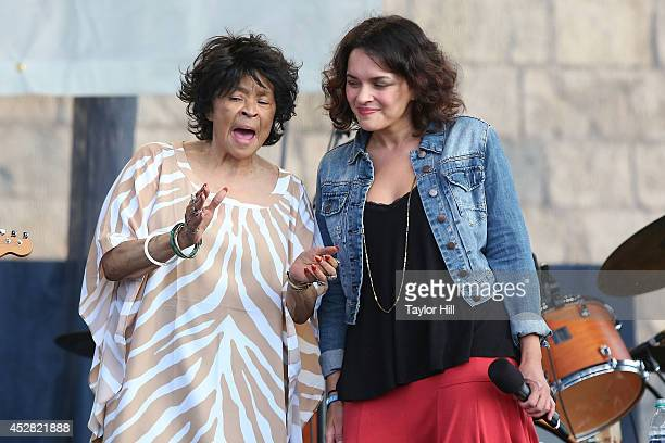 Yvonne Staples and Norah Jones perform during the 2014 Newport Folk Festival at Fort Adams State Park on July 27 2014 in Newport Rhode Island