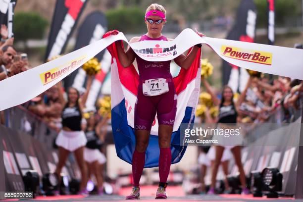 Yvonne Van Vlerken of The Netherlands celebrates as she crosses the finish line and wins IRONMAN Barcelona on September 30 2017 in Calella Barcelona...