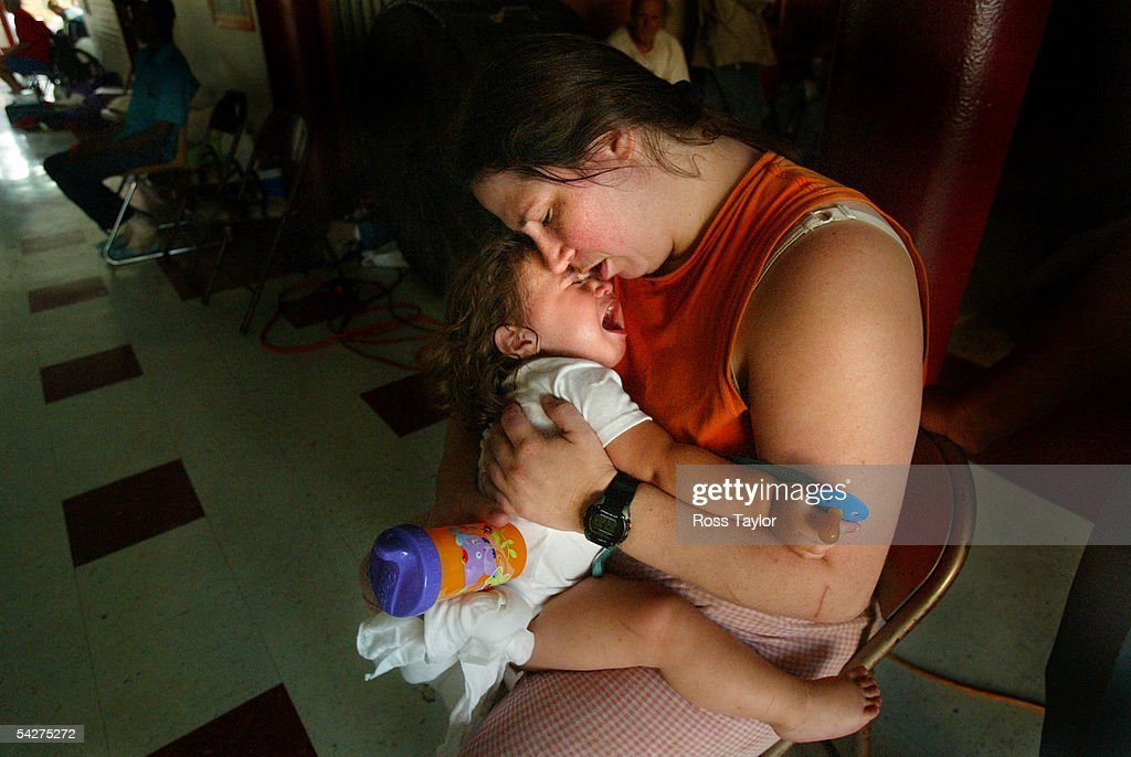 Yvonne Weems holds her child, Mary Weems, at a shelter in the Michele Seventh Grade School September 2, 2005 in Biloxi, Mississippi. Weems is from Biloxi and rode Hurricane Katrina out on the roof of her home which was later completely destroyed and has been at the shelter since the hurricane.