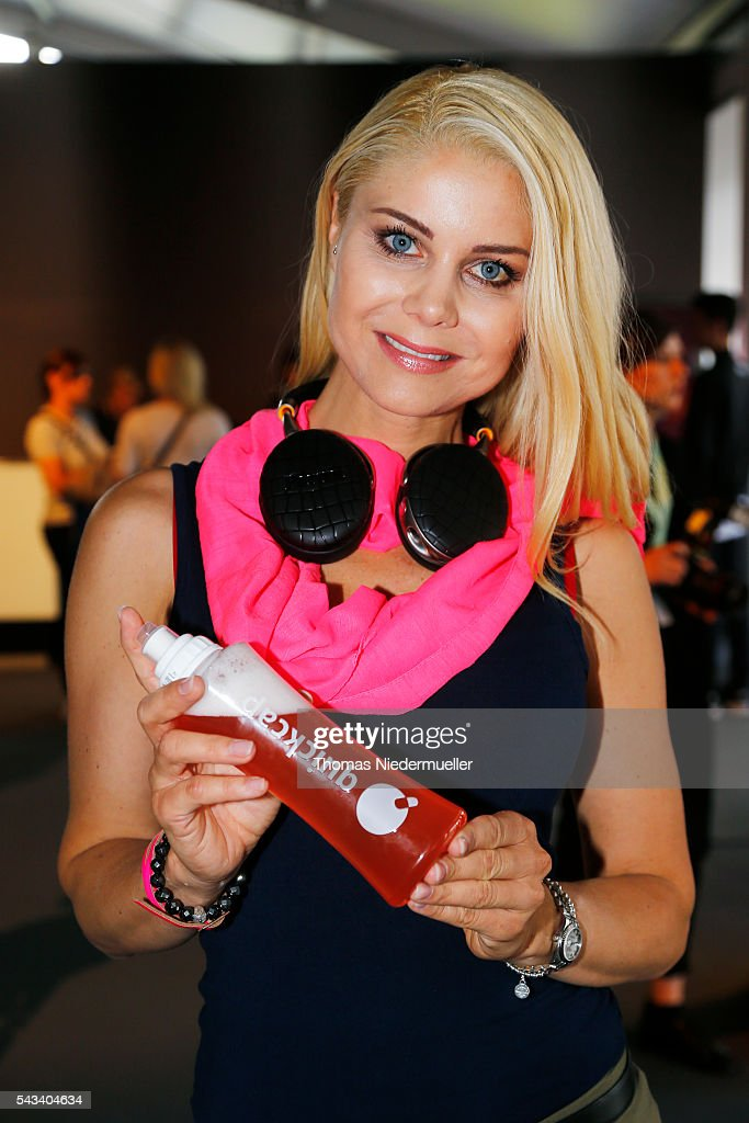 Yvonne Woelke with a bottle of Quickcap during the Mercedes-Benz Fashion Week Berlin Spring/Summer 2017 at Erika Hess Eisstadion on June 28, 2016 in Berlin, Germany.