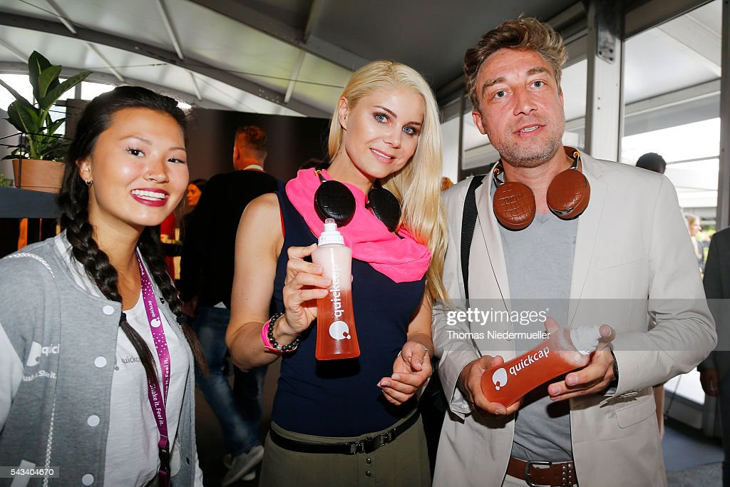 Yvonne Woelke (C) with a bottle of Quickcap during the Mercedes-Benz Fashion Week Berlin Spring/Summer 2017 at Erika Hess Eisstadion on June 28, 2016 in Berlin, Germany.