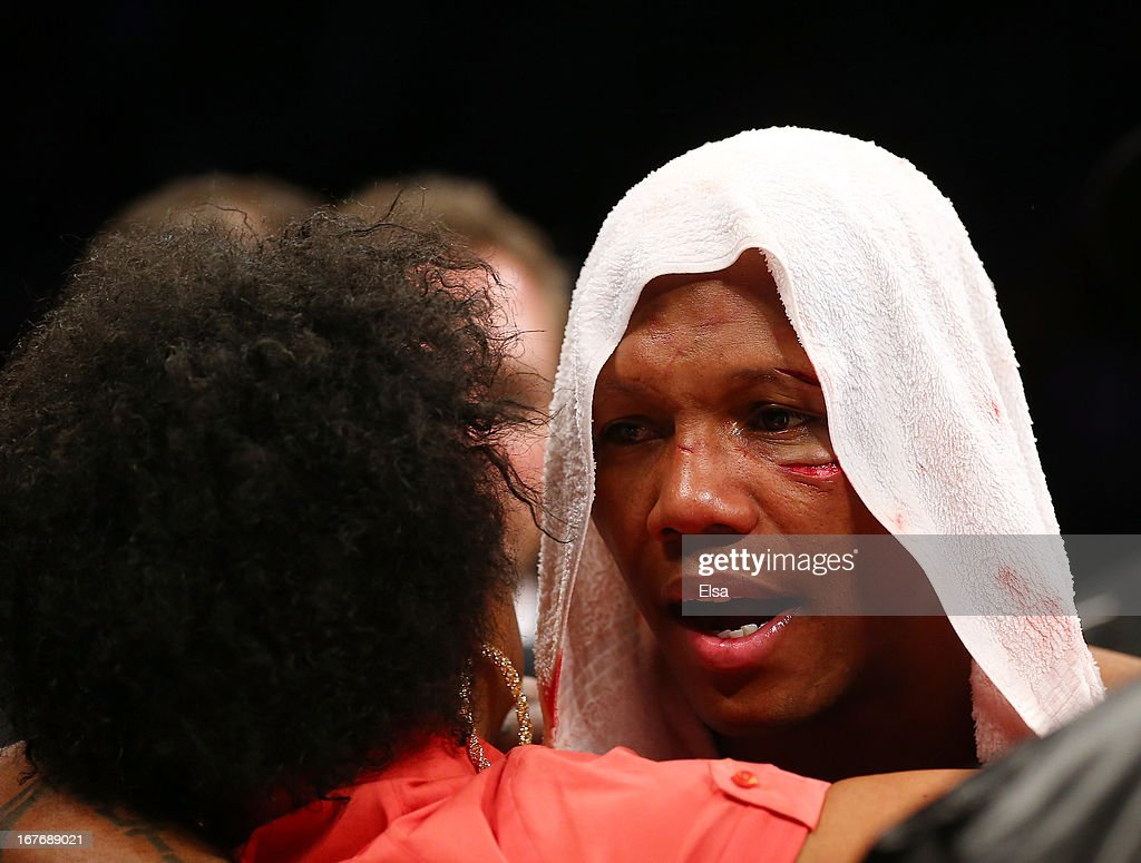<a gi-track='captionPersonalityLinkClicked' href=/galleries/search?phrase=Zab+Judah&family=editorial&specificpeople=172008 ng-click='$event.stopPropagation()'>Zab Judah</a> is consoled after losing the WBA Super and WBC Super Lightweight title fight to Danny Garcia at Barclays Center on April 27, 2013 in the Brooklyn borough of New York City.