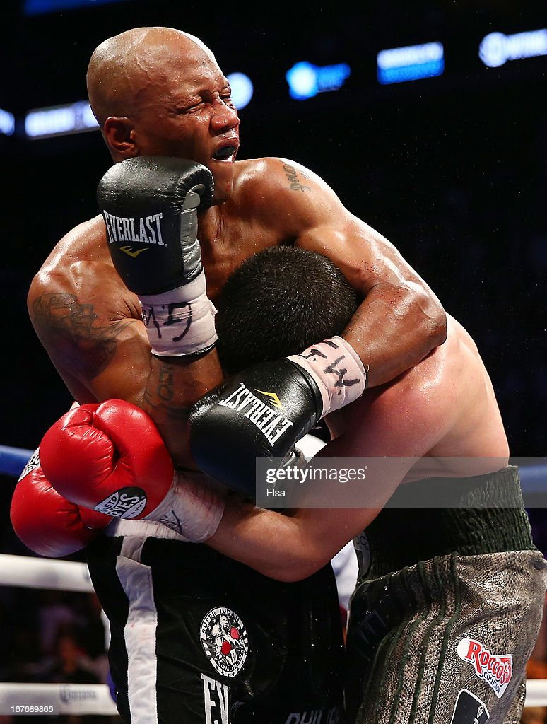 <a gi-track='captionPersonalityLinkClicked' href=/galleries/search?phrase=Zab+Judah&family=editorial&specificpeople=172008 ng-click='$event.stopPropagation()'>Zab Judah</a> puts Danny Garcia in a head lock during the WBA Super and WBC Super Lightweight title fight at Barclays Center on April 27, 2013 in the Brooklyn borough of New York City.Garcia was declared the winner after 12 rounds.