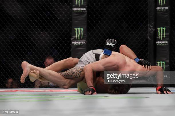 Zabit Magomedsharipov of Russia up fights with Sheymon Moraes down during the UFC Fight Night at MercedesBenz Arena on November 25 2017 in Shanghai...