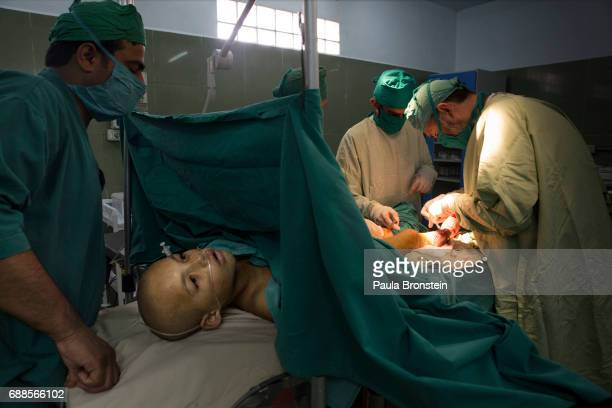 Zabiullah has surgery on his leg in the Emergency hospital operation room he needed a skin graph from severe burns that he got from a mine injury'n...