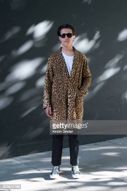 Zac Battle wears a Wackomania coat New Goons trousers Ray Ban sunglasses and Converse trainers on day 1 of London Collections Men on June 9 2017 in...