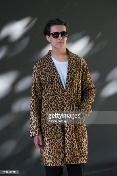 Zac Battle wears a Wackomania coat Ray Ban sunglasses on day 1 of London Collections Men on June 9 2017 in Paris France