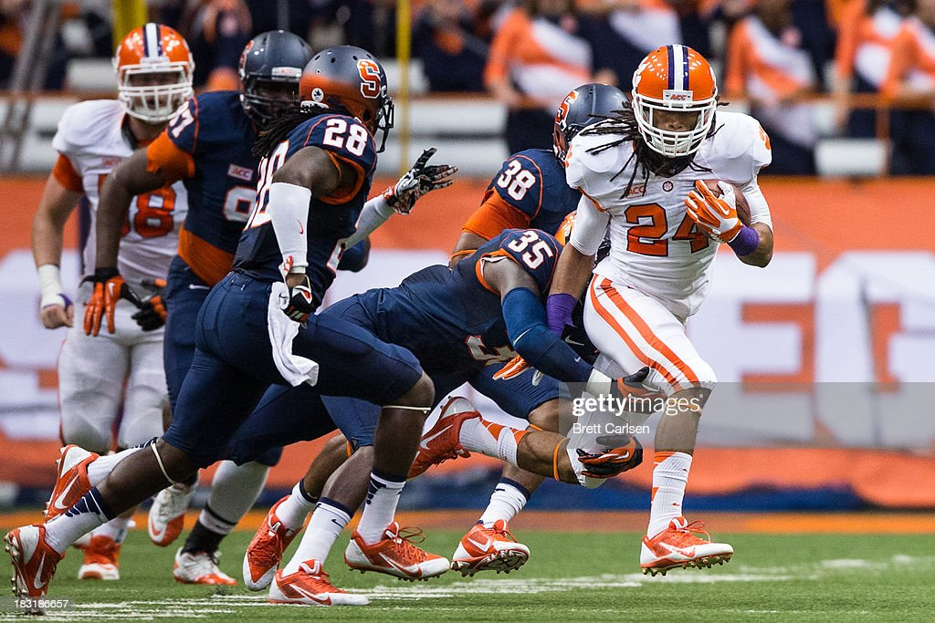 Zac Brooks #24 of Clemson Tigers is brought down by Dyshawn Davis #35 of Syracuse Orange in the first quarter on October 5, 2013 at the Carrier Dome in Syracuse, New York. Clemson defeated Syracuse 49-14.
