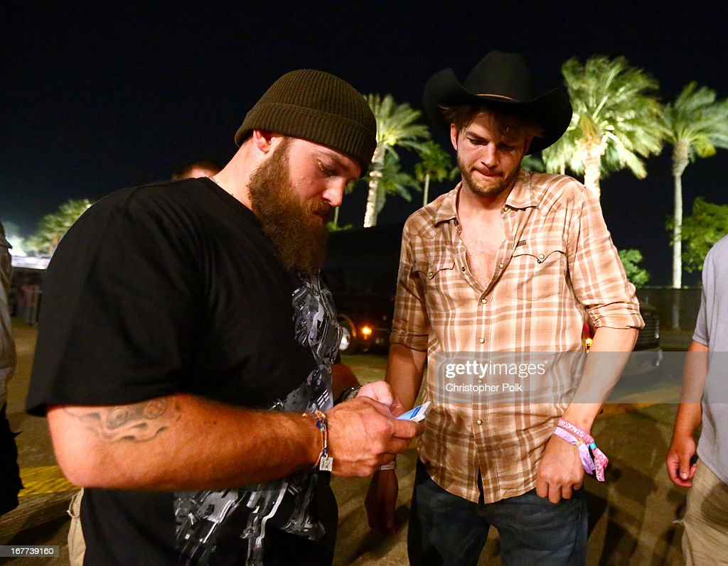 Zac Brown (L) and Ashton Kutcher are seen during 2013 Stagecoach: California's Country Music Festival held at The Empire Polo Club on April 28, 2013 in Indio, California.