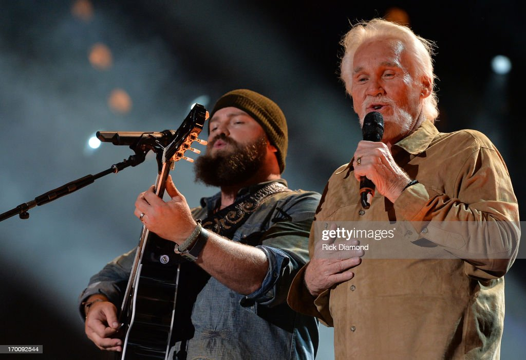Zac Brown is joined on stage by Kenny Rogers to perform 'The Gambler' during the 2013 CMA Music Festival on June 6, 2013 in Nashville, Tennessee.