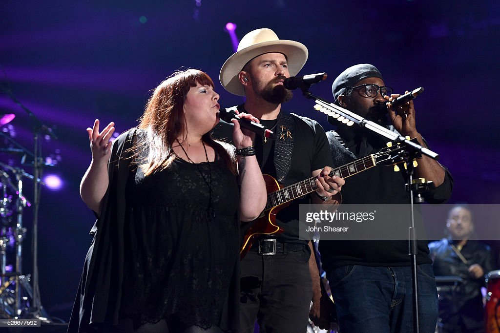 <a gi-track='captionPersonalityLinkClicked' href=/galleries/search?phrase=Zac+Brown+-+Singer&family=editorial&specificpeople=6705520 ng-click='$event.stopPropagation()'>Zac Brown</a> (C) of <a gi-track='captionPersonalityLinkClicked' href=/galleries/search?phrase=Zac+Brown+-+Singer&family=editorial&specificpeople=6705520 ng-click='$event.stopPropagation()'>Zac Brown</a> Band performs onstage during the 2016 iHeartCountry Festival at The Frank Erwin Center on April 30, 2016 in Austin, Texas.