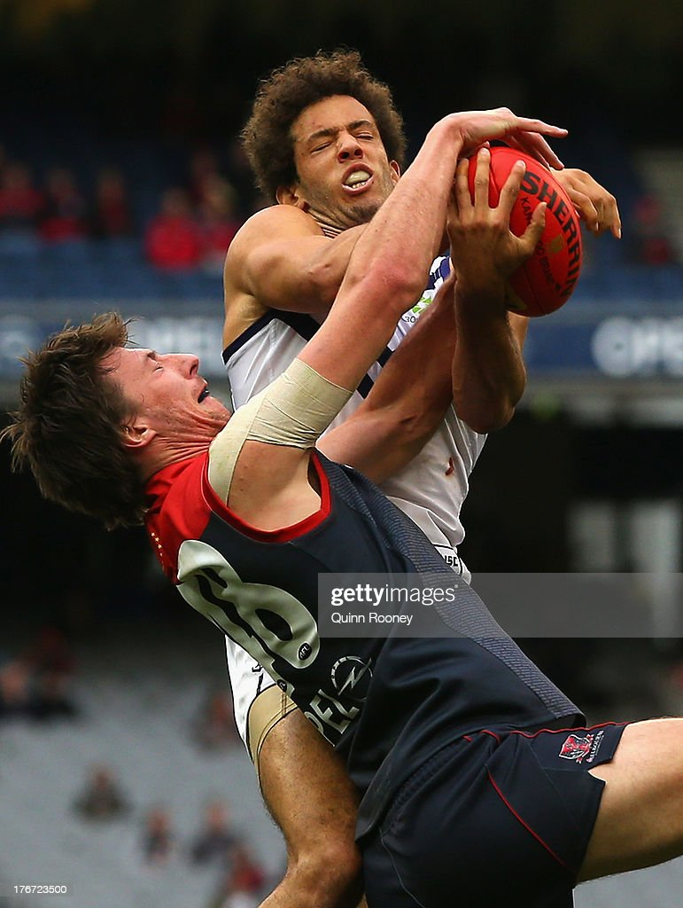 Zac Clarke of the Dockers marks over the top of Jack Fitzpatrick of the Demons during the round 21 AFL match between the Melbourne Demons and the Fremantle Dockers at Melbourne Cricket Ground on August 18, 2013 in Melbourne, Australia.