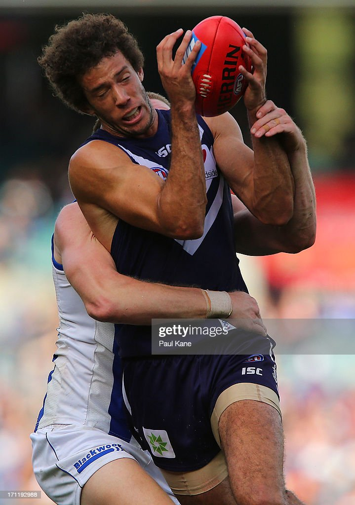 Zac Clarke of the Dockers marks the ball against Lachlan Hansen of the Kangaroos during the round 13 AFL match between the Fremantle Dockers and the North Melbourne Kangaroos at Patersons Stadium on June 23, 2013 in Perth, Australia.