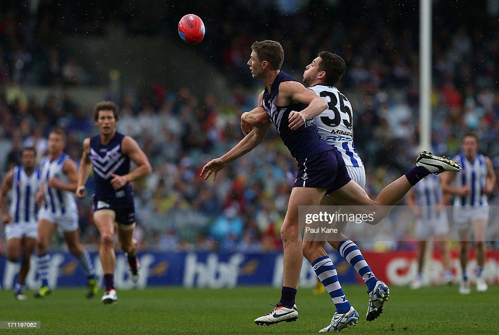 Zac Dawson of the Dockers and Aaron Black of the Kangaroos contest for the ball during the round 13 AFL match between the Fremantle Dockers and the North Melbourne Kangaroos at Patersons Stadium on June 23, 2013 in Perth, Australia.