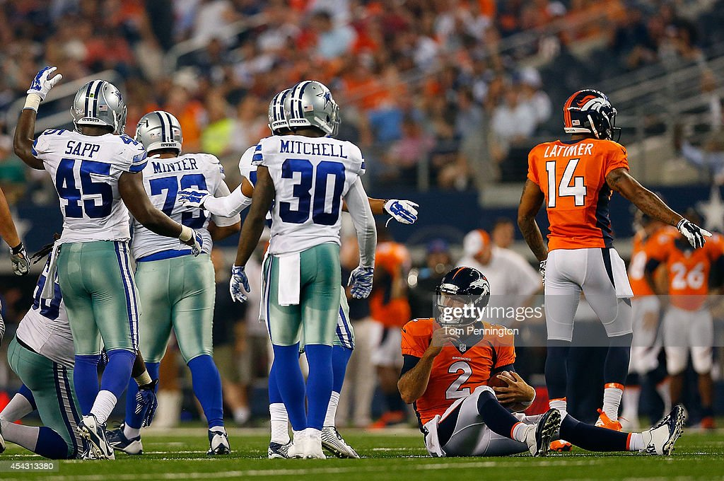 Zac Dysert #2 of the Denver Broncos sits on the ground after being sacked by the Dallas Cowboys in the second half of their preseason game at AT&T Stadium on August 28, 2014 in Arlington, Texas.