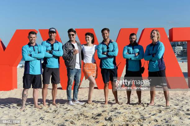 Zac Efron and Alexandra Daddario pose with Bondi Lifeguards at the 'Baywatch' photo call at Bondi Beach on May 17 2017 in Sydney Australia