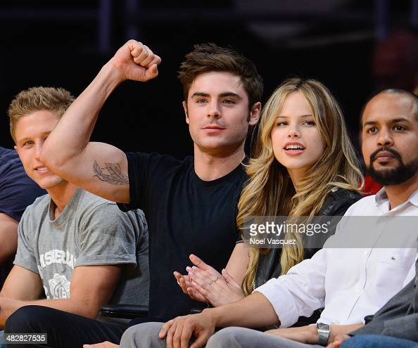 Zac Efron and Halston Sage attend a basketball game between the Dallas Mavericks and the Los Angeles Lakers at Staples Center on April 4 2014 in Los...