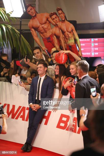 Zac Efron poses with the crowd sounded by cardboard cutouts of himself ahead of the Australian Premiere of Baywatch on May 18 2017 in Sydney Australia