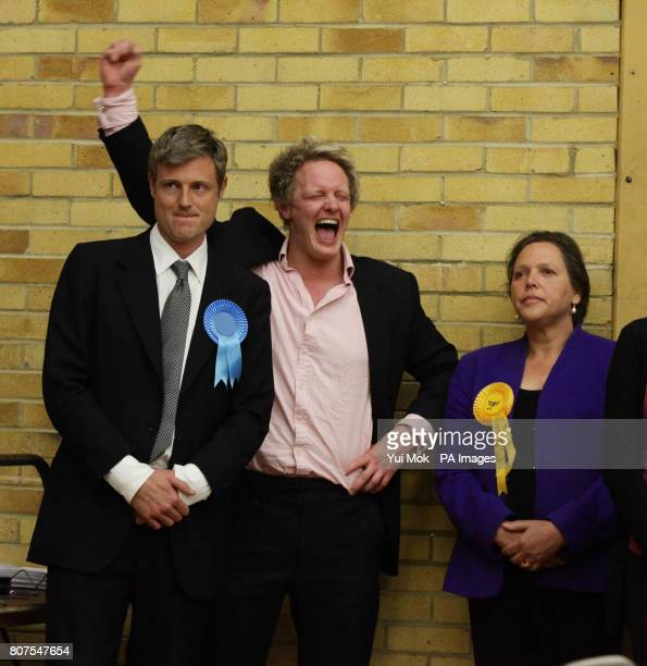 Zac Goldsmith celebrates winning the seat for Richmond Park with his election agent David Newman as defeated Liberal Democrat candidate Susan Kramer...