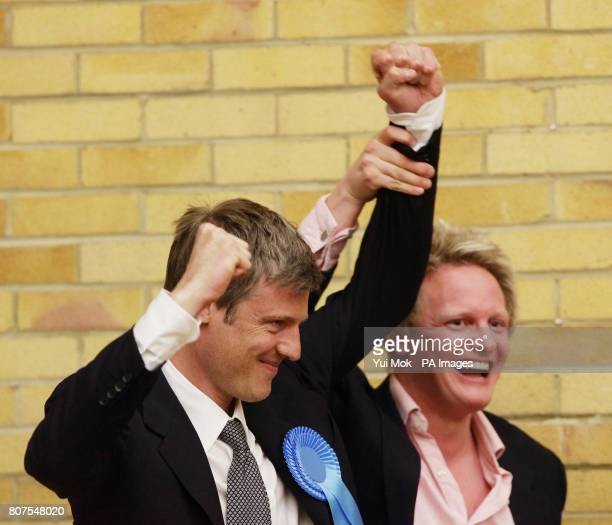 Zac Goldsmith celebrates winning the seat for Richmond Park with his election agent David Newman at Richmond upon Thames College