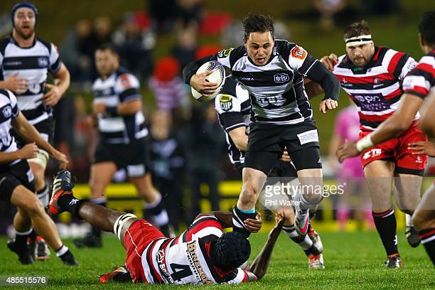 Zac Guildford of Hawkes Bay is tackled during the round three ITM Cup match between Counties Manukau and Hawkes Bay at ECOLight Stadium on August 28...