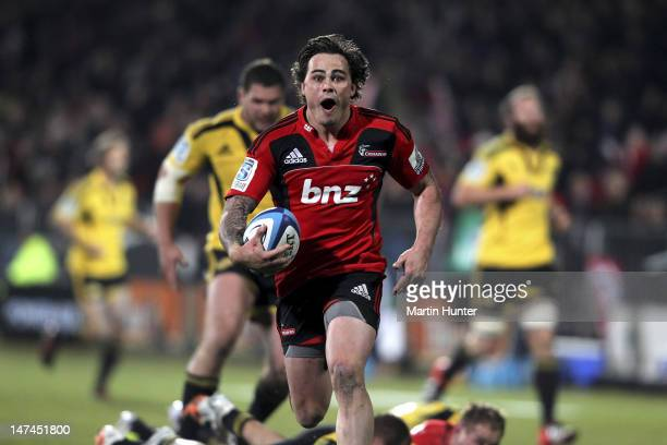 Zac Guildford of the Crusaders runs away to score a try during the round 16 Super Rugby match between the Crusaders and the Hurricanes at AMI Stadium...