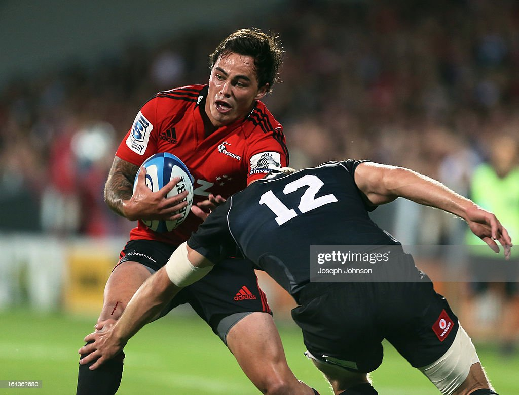 <a gi-track='captionPersonalityLinkClicked' href=/galleries/search?phrase=Zac+Guildford&family=editorial&specificpeople=4252939 ng-click='$event.stopPropagation()'>Zac Guildford</a> of the Crusaders runs into the tackle of Hadleigh Parkes of the Kings during the round six Super Rugby match between the Crusaders and the Kings at AMI Stadium on March 23, 2013 in Christchurch, New Zealand.