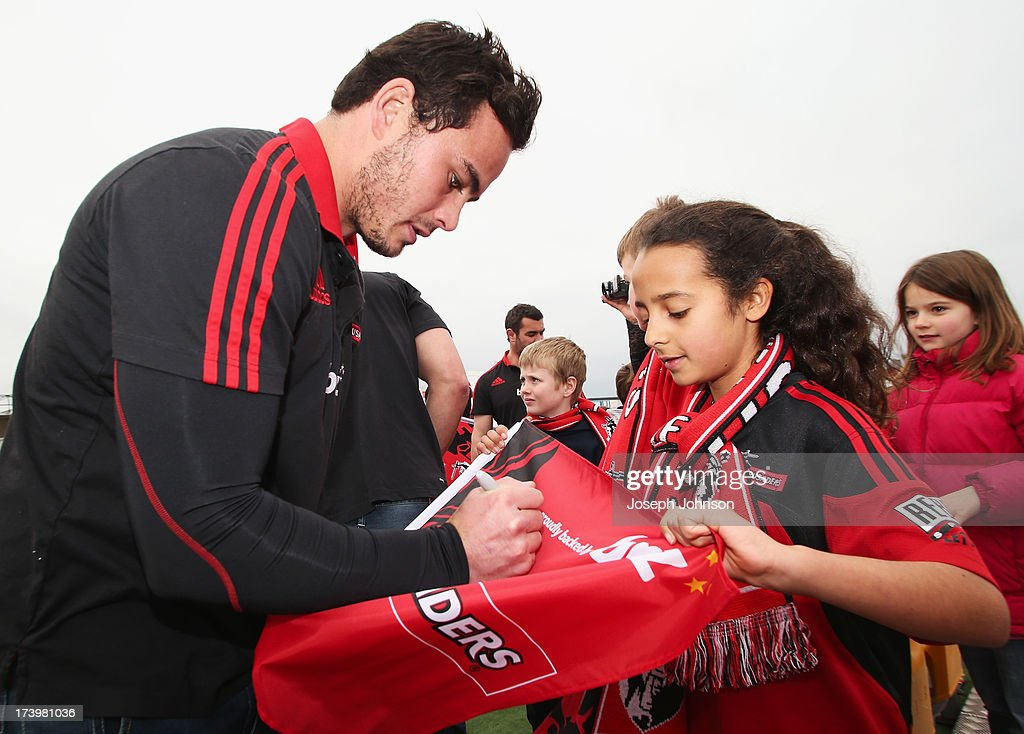 Zac Guildford of the Crusaders sign autographs after a media announcement that BNZ will be naming rights sponsor of the Crusaders on July 19, 2013 in Christchurch, New Zealand.