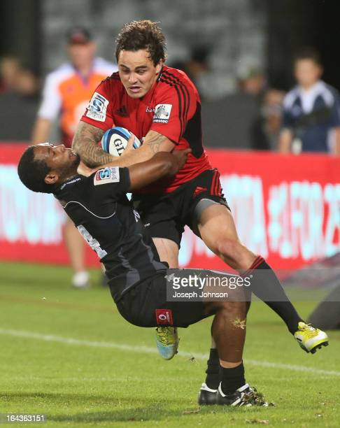 Zac Guildford of the Crusaders with the ball in the tackle of Sergeal Petersen of the Kings during the round six Super Rugby match between the...