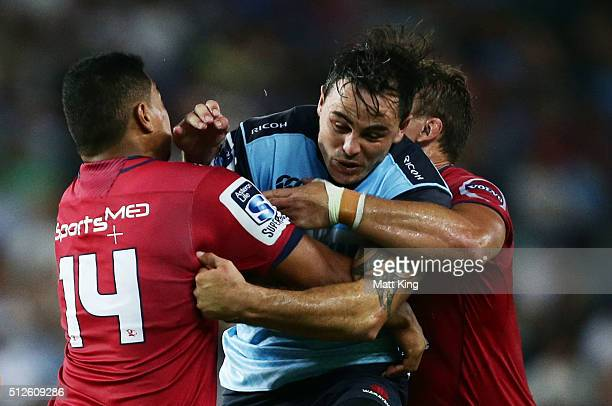 Zac Guildford of the Waratahs is tackled during the round one Super Rugby match between the Waratahs and the Reds at Allianz Stadium on February 27...