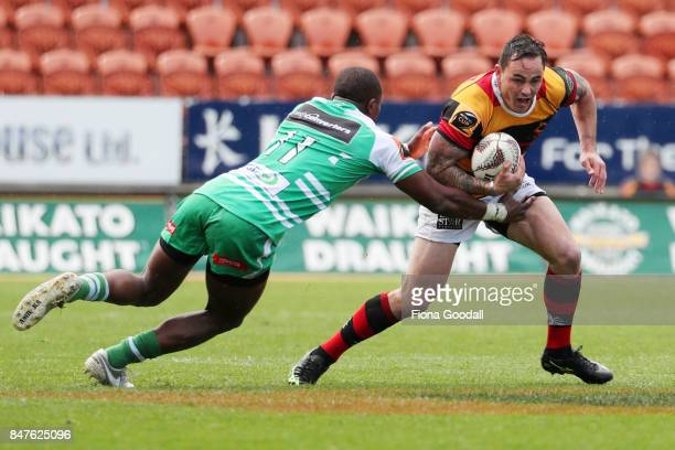 Zac Guildford of Waikato is tackled by William Ambaka of Manawatu during the round five Mitre 10 Cup match between Waikato and Manawatu at FMG...