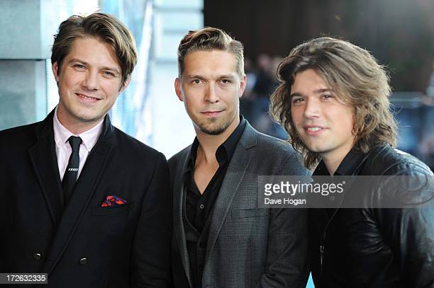 Zac Hanson Taylor Hanson and Isaac Hanson of Hanson attend the European premiere of 'Pacific Rim' at The BFI IMAX on July 4 2013 in London England