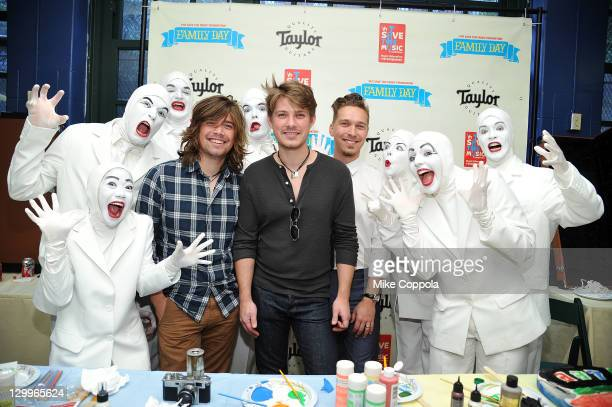 Zac Hanson Taylor Hanson and Isaac Hanson of the band Hanson are surrounded by the Vocal People during the VH1 Save the Music Foundation Family Day...
